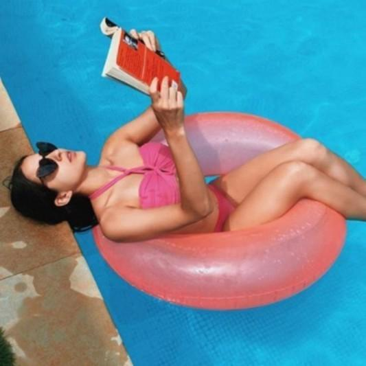 Sara Ali Khan lazing in the pool with a book in a hot pink bikini is a whole weekend mood; See PHOTOS