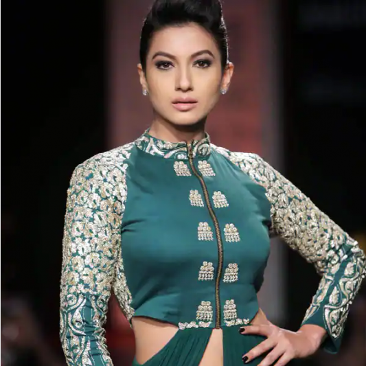 Gauahar Khan strongly HITS BACK at a pap asking her to remove her mask; asks Aap konse times mein chal rahe ho watch video